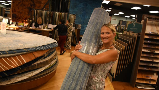 Babette Koncz of Estates Elementary School gives her rug a hug.