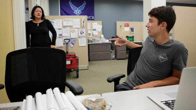 Founder and executive director of Ventura County Military Collaborative Kim Evans speaks with her son, Zak Evans, about a GoFundMe page at her office in Camarillo.
