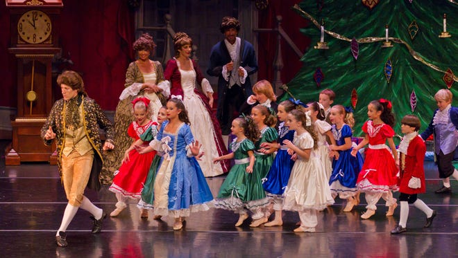 "Barry Trammell (left), acting as Uncle Drosselmeyer, leads Olivia Schulke (left in blue dress), acting as Clara Stalbaum, and the party girls and boys on a hunt for the Columbine Doll which he brought to the party in this 2011 Vero Classical Ballet performance of ""The Nutcracker."" Audition for this year's performance are Saturday."