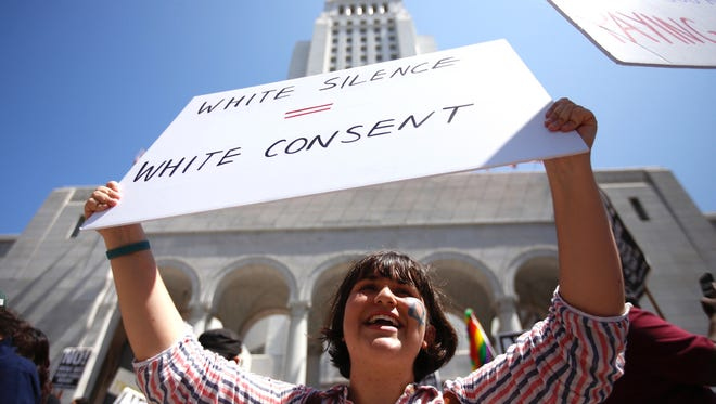 Juliette Polonsky, Pasadena in a during rally a local group calling itself Refuse Fascism rallies at City Hall in Los Angeles to denounce the violence and honor the victims in Charlottesville, Virginia August 13, 2017. (Francine Orr/ Los Angeles Times/TNS)