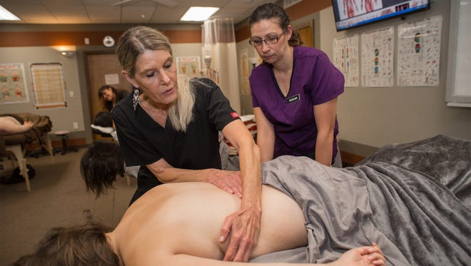 Students, teachers and patients gather at the Massage Therapy Training Institute in Las Cruces.
