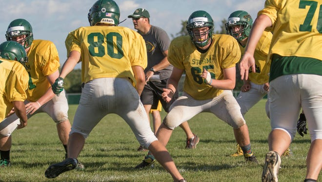 Gage Donovan (65) works his way through line drills during practice Tuesday, Aug. 22, at Sauk Rapids-Rice High School.