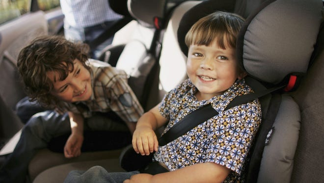 Charlie and Harry Woodhouse sit in their new child seats on September 17, 2006.