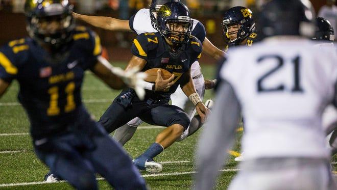 Naples High quarterback Jordan Persad-tirone runs during a game between Naples High School and Miami Palmetto Senior High School in Naples on September 1, 2017.