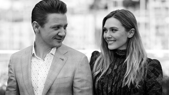 Jeremy Renner and Elizabeth Olsen pose on May 20, 2017 during a photocall for the film 'Wind River' at the 70th edition of the Cannes Film Festival in Cannes, southern France.