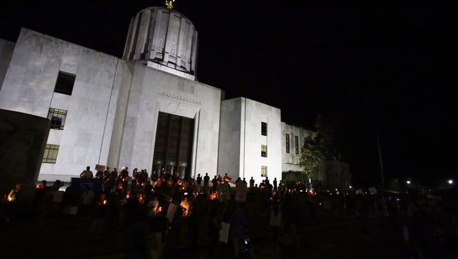 More than one hundred people gathered in front of the Oregon State Capitol to support Deferred Action for Childhood Arrivals, or DACA, on the night of Sunday, Sept. 3, 2017.