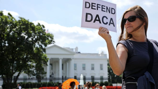 Demonstrators at the White House last month urged President Trump to maintain the Deferred Action  for Childhood Arrivals program, or DACA. Trump said Tuesday he would eliminate it.