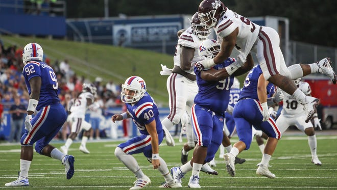 Mississippi State's Jeffery Simmons (94) goes high in the air to block a punt by Louisiana Tech's Brady Farlow.