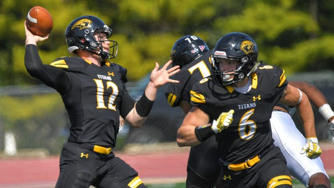 Titan quarterback Brett Kasper (12) gets ready to pass in the first quarter. The UW-O Titans hosted the Virginia University at Lynchburg Dragons Saturday afternoon, September 9, 2017 at J. J. Keller Field at Titan Stadium.