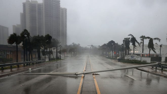 East Oakland Park Boulevard is completely blocked by a downed street light pole as Hurricane Irma hits the southern part of the state on September 10, 2017 in Fort Lauderdale, Fla.