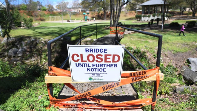 A bridge is closed for renovations in McPherson Park on Friday, April 7, 2017.