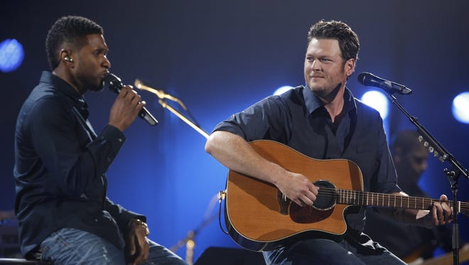 Usher, left, and Blake Shelton perform during the Healing in the Heartland benefit concert Wednesday night in Oklahoma City. The show reportedly raised more than $6 milion for tornado victims.