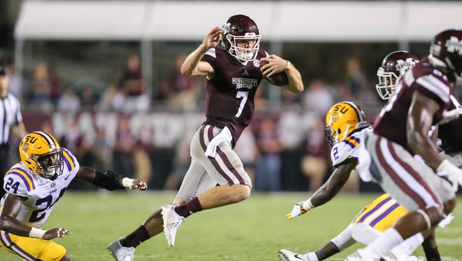 Mississippi State's Nick Fitzgerald (7) changes directions to avoid LSU's Tyler Taylor (24) and LSU's Kevin Toliver II (2). Mississippi State and LSU played in an SEC college football game on Saturday, September 16, 2017 at Davis Wade Stadium in Starkville. Photo by Keith Warren (Mandatory Credit)