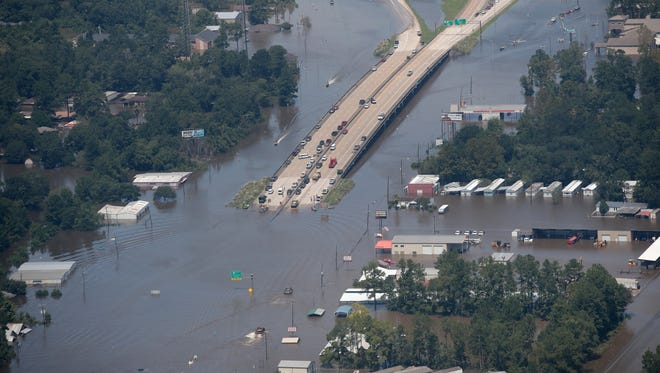 A road is covered by floodwater left in the wake of Hurricane and Tropical Storm Harvey on August 31, 2017 near Houston, Texas. Harvey, which made landfall north of Corpus Christi August 25, has dumped nearly 50 inches of rain in and around the Houston area.