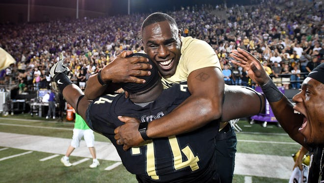 Vanderbilt coach Derek Mason hugs defensive lineman Jay Woods (74) after defeating Kansas State on Saturday, Sept. 16, 2017.