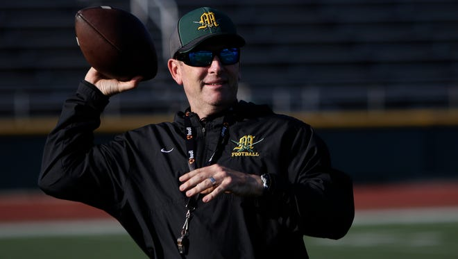 Moorpark head coach Ryan Huisenga warms up with his team during practice at Moorpark High on Wednesday. The unbeaten Musketeers play at unbeaten Westlake on Friday night.