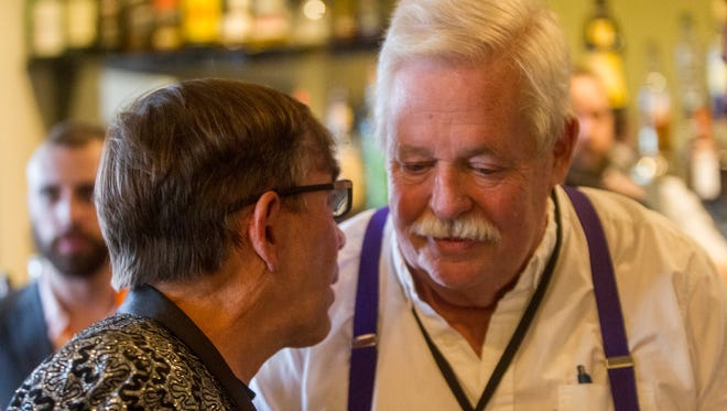 """Writer Armistead Maupin speaks to Palm Springs Mayor Rob Moon Thursday during the presentation of """"Untold Tales of Armistead Maupin"""" at the Camelot Theater in Palm Springs"""