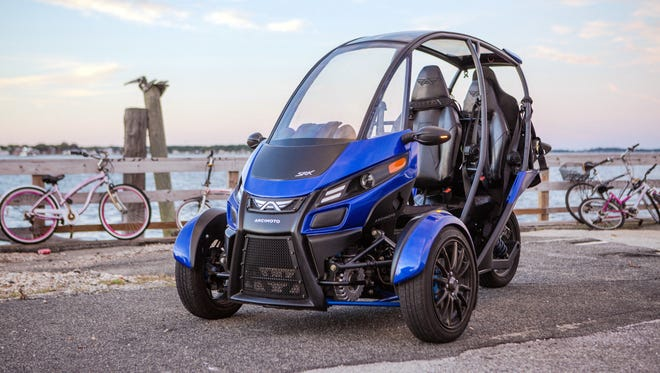 "This undated photo provided by Arcimoto shows an electric vehicle produced by the Oregon-based company. Arcimoto raised nearly $20 million in a recent initial public offering and its founder says the firm is on track to deliver its first vehicles to customers this year. Arcimoto shares will begin trading Thursday, Sept. 21, 2017 on Nasdaq under the ticker symbol FUV, which stands for ""fun utility vehicle."""