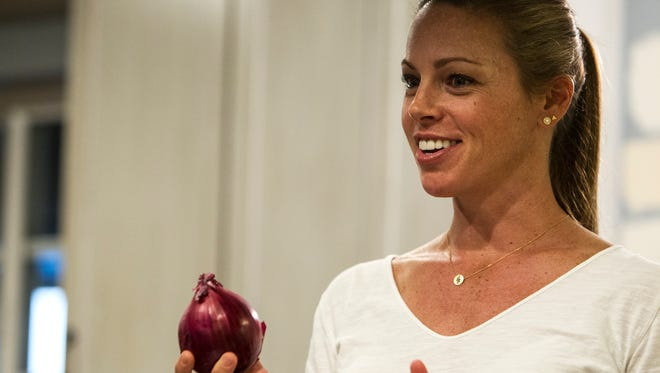 Maggie Norris talks about technique for cutting onions during a private class at Whisked Away, a cooking school for home chefs, on Sept. 12, 2017, in Phoenix. Norris has been teaching the classes from her home since 2009.