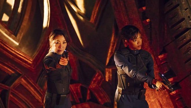 First Officer Michael Burnham (Sonequa Martin-Green), right, serves under Captain Phillippa Georgiou (Michelle Yeoh) on the USS Shenzhou on 'Star Trek: Discovery.'