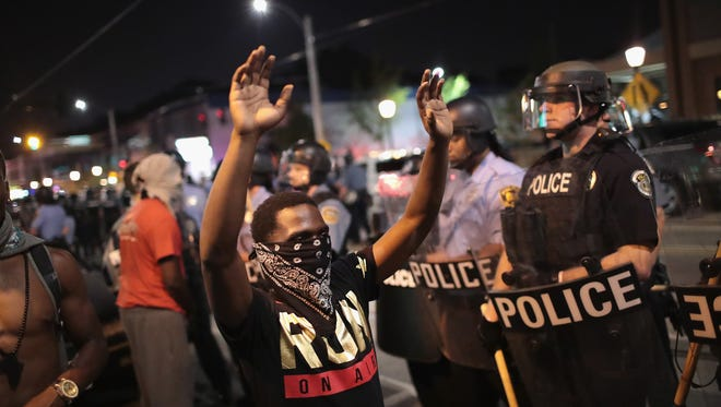 Demonstrators confront police while protesting the acquittal of former St. Louis police officer Jason Stockley.
