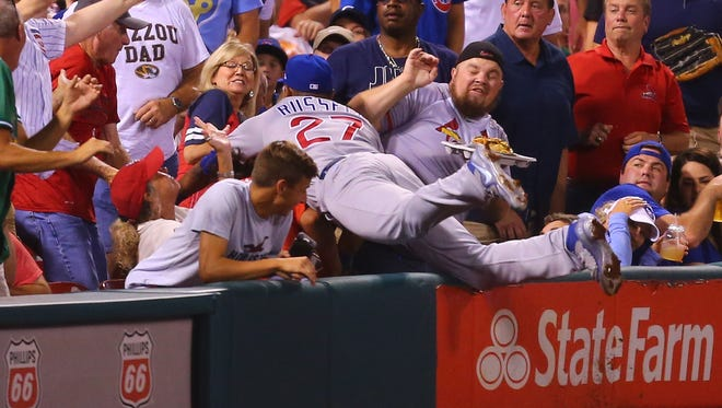 Addison Russell #27 of the Chicago Cubs attempts to catch a foul ball against the St. Louis Cardinals in the second inning at Busch Stadium on September 25, 2017 in St. Louis, Missouri.  (Photo by Dilip Vishwanat/Getty Images)