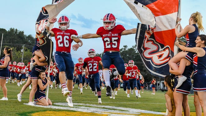 Thomas Stevens and Collin Kirsch lead the Pios on the field as The Kaplan Pirates travel to Gardner Memorial Stadium to take on The Notre Dame Pios. Thursday, Sept. 28, 2017.