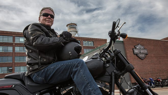 Jody Reinisch, mayor of Ryder, N.D., test rides a 2018 Harley-Davidson Fat Boy at Harley's headquarters in Milwaukee. Ryder recently became the first town in America where Harley-Davidson attempted to get everyone signed up for motorcycle riding classes that would lead to their bike driving license. About 70% of the town's eligible residents accepted Harley's offer.