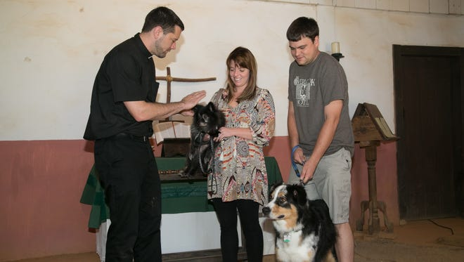 Fr. Matthew Busch performing blessing of pets at Mission San Luis in 2016.