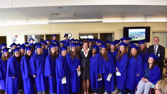 Gov. Kim Reynolds spoke at the graduation ceremony at Mitchellville women's prison.
