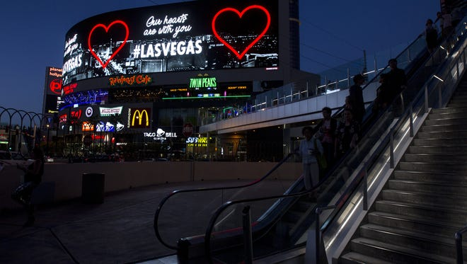 """A message stating """"Our hearts are with you"""" is displayed along Las Vegas Boulevard on Tuesday, Oct. 3, 2017 in Las Vegas, Nev. Stephen Paddock was accused of shooting into a crowd of people at a concert from his hotel room at Mandalay Bay in Las Vegas on Sunday night, resulting in the deadliest mass shooting in U.S. history."""