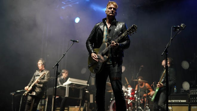 Josh Homme of Queens of the Stone Age performs Aug. 25, 2017, during a surprise gig in the NME/Radio 1 tent at the 2017 Reading Festival.
