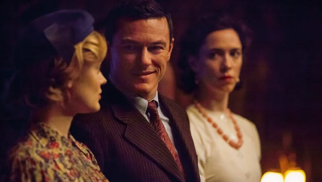 "Bella Heathcote (from left) plays Olive Byrne, Luke Evans is ""Wonder Woman"" creator William Marston and Rebecca Hall is Elizabeth Marston in ""Professor Marston & the Wonder Women."""