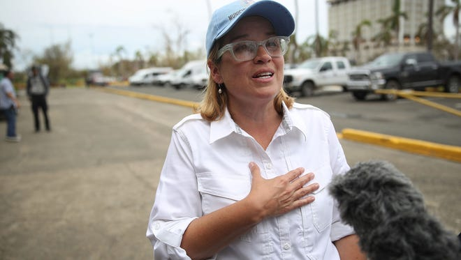 San Juan Mayor Carmen Yulin Cruz speaks to the media as she arrives at the temporary government center setup at the Roberto Clemente stadium in the aftermath of Hurricane Maria on Sept. 30, 2017 in San Juan, Puerto Rico.