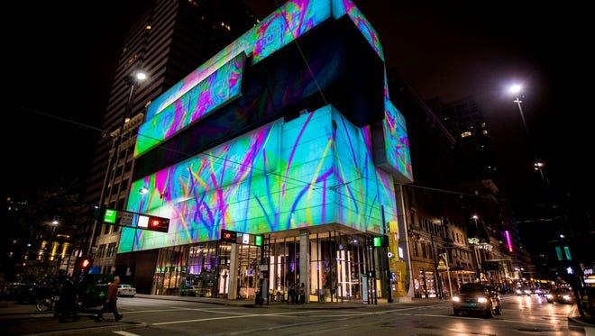 A video projection from Lightborne illuminates the Contemporary Art Center on Sixth Street as part of Blink Cincinnati.