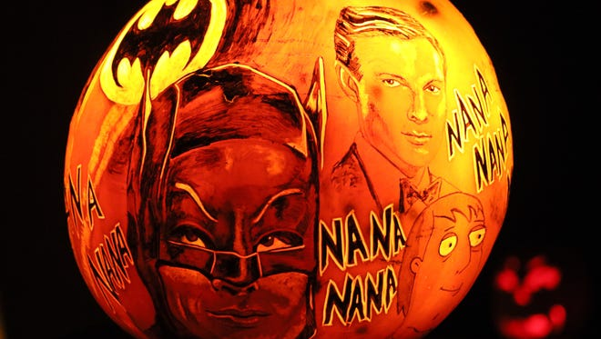 Batman is one of the superheros spotted at the Jack-O-Lantern Spectacular at Iroquois Park in Louisville, KY. Oct. 13, 2017