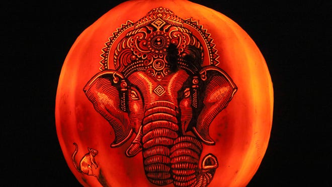An intricately-carved elephant on a pumpkin along the path at the Jack-O-Lantern Spectacular at Iroquois Park in Louisville, KY. Oct. 13, 2017