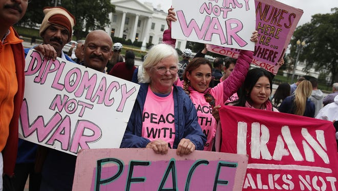 """Activists participate in a protest in front of the White House on Oct. 12, 2017 in Washington, D.C. Activists held a rally to """"denouncing President Trump's decision to decertify the Iran nuclear deal."""""""