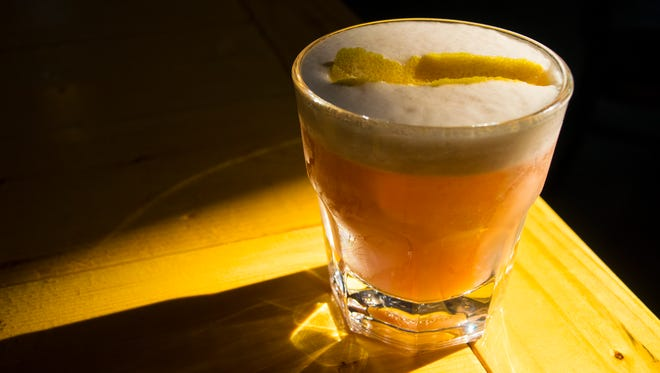 """The """"Frequent Flyer"""" at Hotel Tango distillery has whiskey, lemon, pomegranate shrub, orange bitters and egg white. A chickpea substitute can be used in place of the egg white to make the cocktail vegan."""