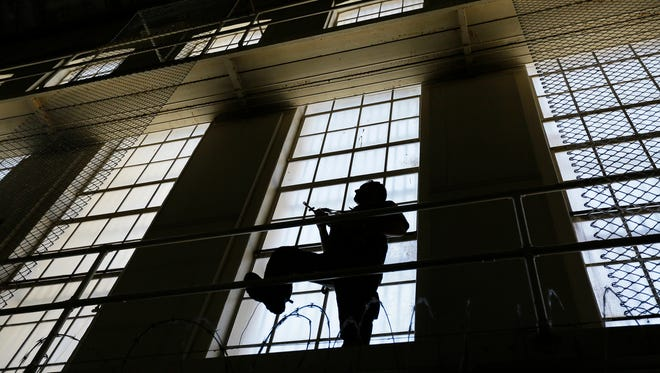 A guard keeps watch over death row at San Quentin State Prison in San Quentin, Calif., last year.