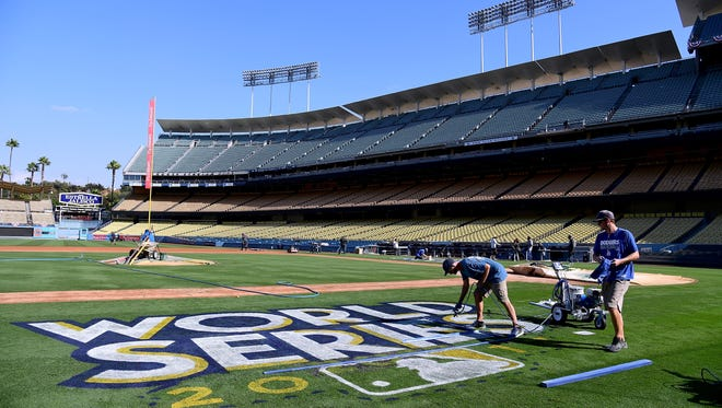 Dodger Stadium preparations are underway for the World Series, which may bring a game-time temperature in the mid-90s.