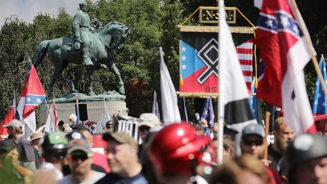 Hundreds of white nationalists gather at a statue of Confederate Gen. Robert E. Lee for a Unite the Right rally Aug.12 in Charlottesville, Va. A smaller rally by the same organizer was held in the city Saturday.