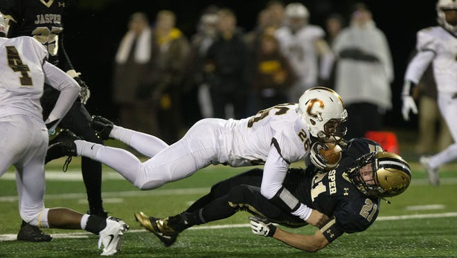 Central's Dylan Carrier tackles Jasper's Ryan Ewing as he rushed for yards in the second half of the Class 4A sectional game Friday evening at Jerry Brewer Alumni Stadium in Japser. Central defeated Jasper 26-15.
