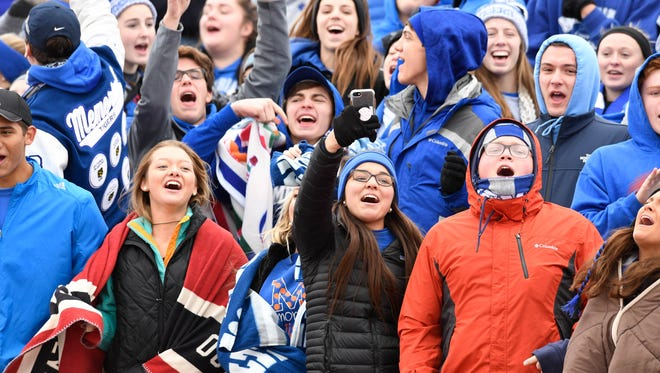 The Memorial student section celebrates as the Memorial girls won the Class 2A Girls Indiana High School Athletic Association Soccer State Championship over the St. Joseph Indians at Michael A. Carroll Stadium in Indianapolis Saturday, October 28, 2017.