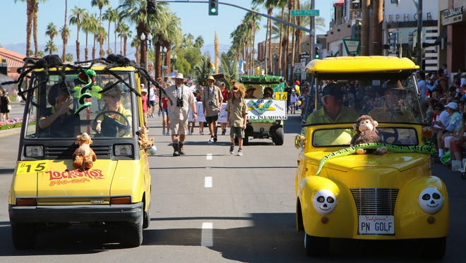 Carts from local businesses ride in the annual golf cart parade in Palm Desert, Sunday, October 29, 2017.