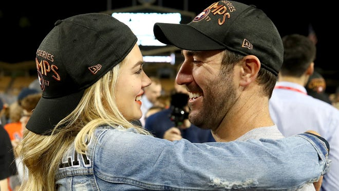 Astros pitcher Justin Verlander celebrates with fiancee Kate Upton after the Astros defeated the Los Angeles Dodgers 5-1 in Game 7 to win the 2017 World Series at Dodger Stadium on Nov. 1, 2017, in Los Angeles.