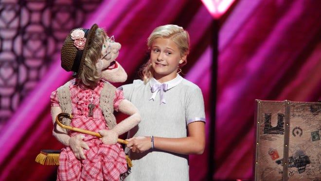 America's Got Talent Season 12 winner Darci Lynne Farmer with one of her puppets.