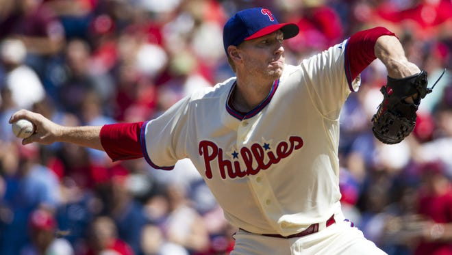 Roy Halladay, seen pitching for the Phillies against the Diamondbacks in 2013, died in a small plane crash in the Gulf of Mexico off the coast of Florida on Tuesday.  Christopher Szagola/AP FILE - In this Aug. 24, 2013, file photo, Philadelphia Phillies starting pitcher Roy Halladay throws a pitch during the first inning of a baseball game against the Arizona Diamondbacks, in Philadelphia. Authorities have confirmed that former Major League Baseball pitcher Roy Halladay died in a small plane crash in the Gulf of Mexico off the coast of Florida, Tuesday, Nov. 7, 2017.  (AP Photo/Christopher Szagola, File)
