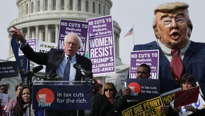 Sen. Bernie Sanders, I-Vt., addresses a rally against the Republican tax plan outside the U.S. Capitol on Nov. 1, 2017.