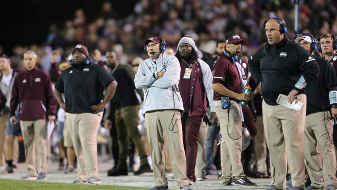 Mississippi State University head football coach Dan Mullen (in grey sweatshirt) calls a play in the first half of MSU's game against Alabama on Saturday, Nov. 11, in Starkville.